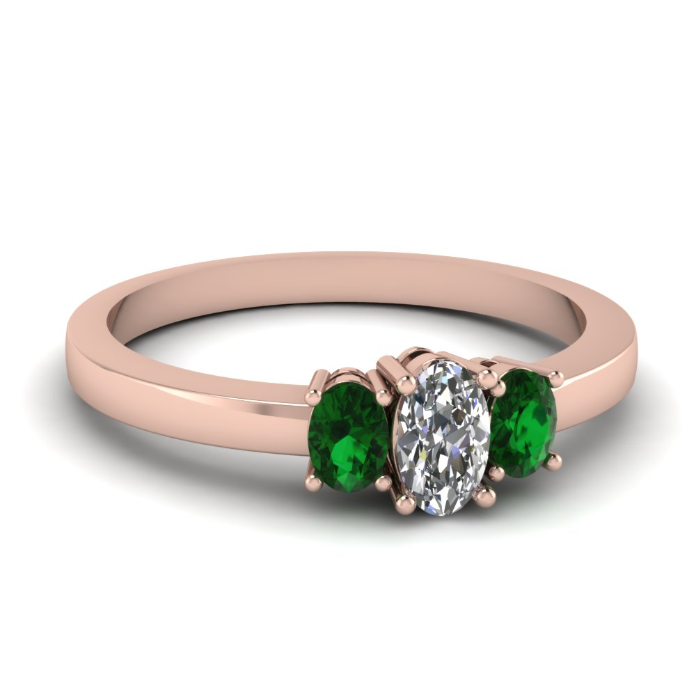 Delicate 3 Stone Emerald Ring