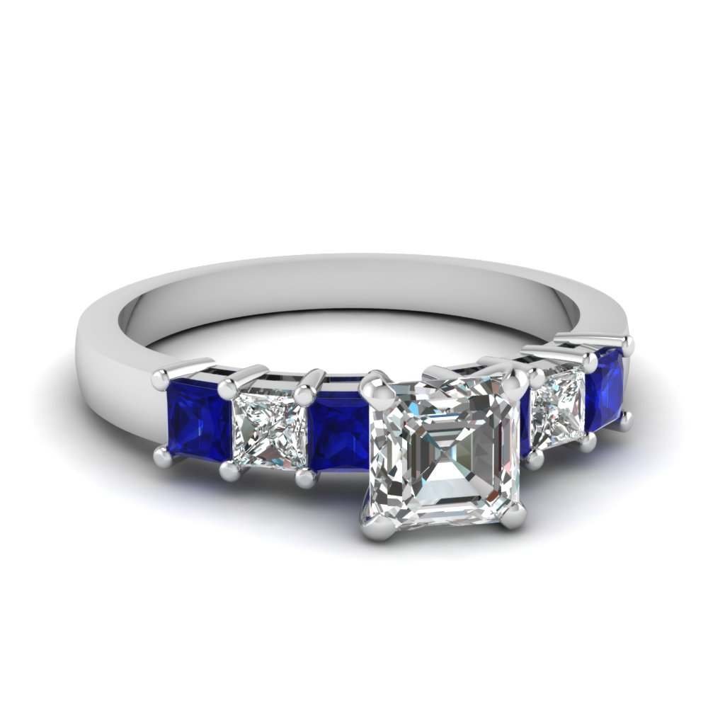 Blue Sapphire And Diamond Side Stone Engagement Ring
