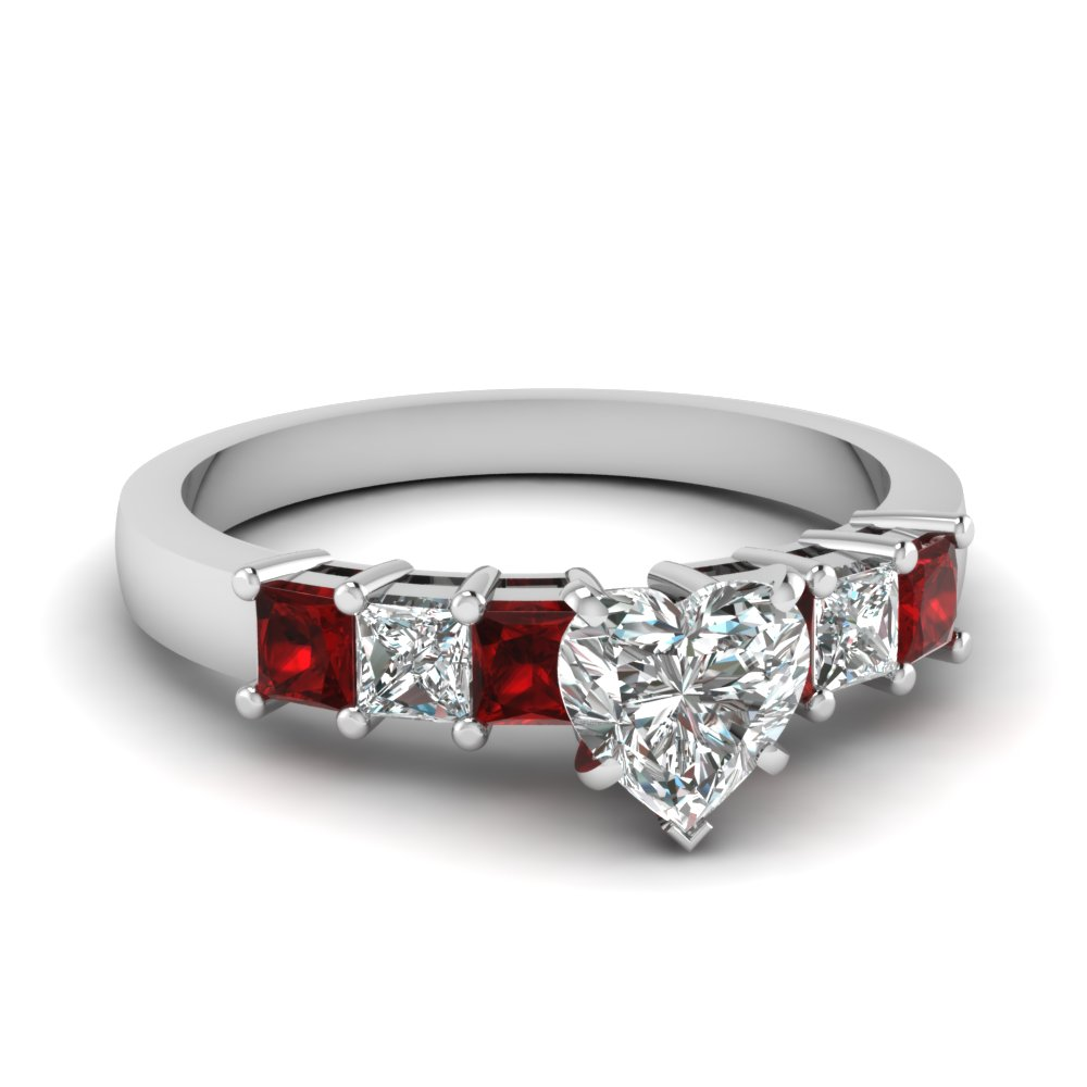 Heart Shaped And Ruby Side Stone Engagement Ring