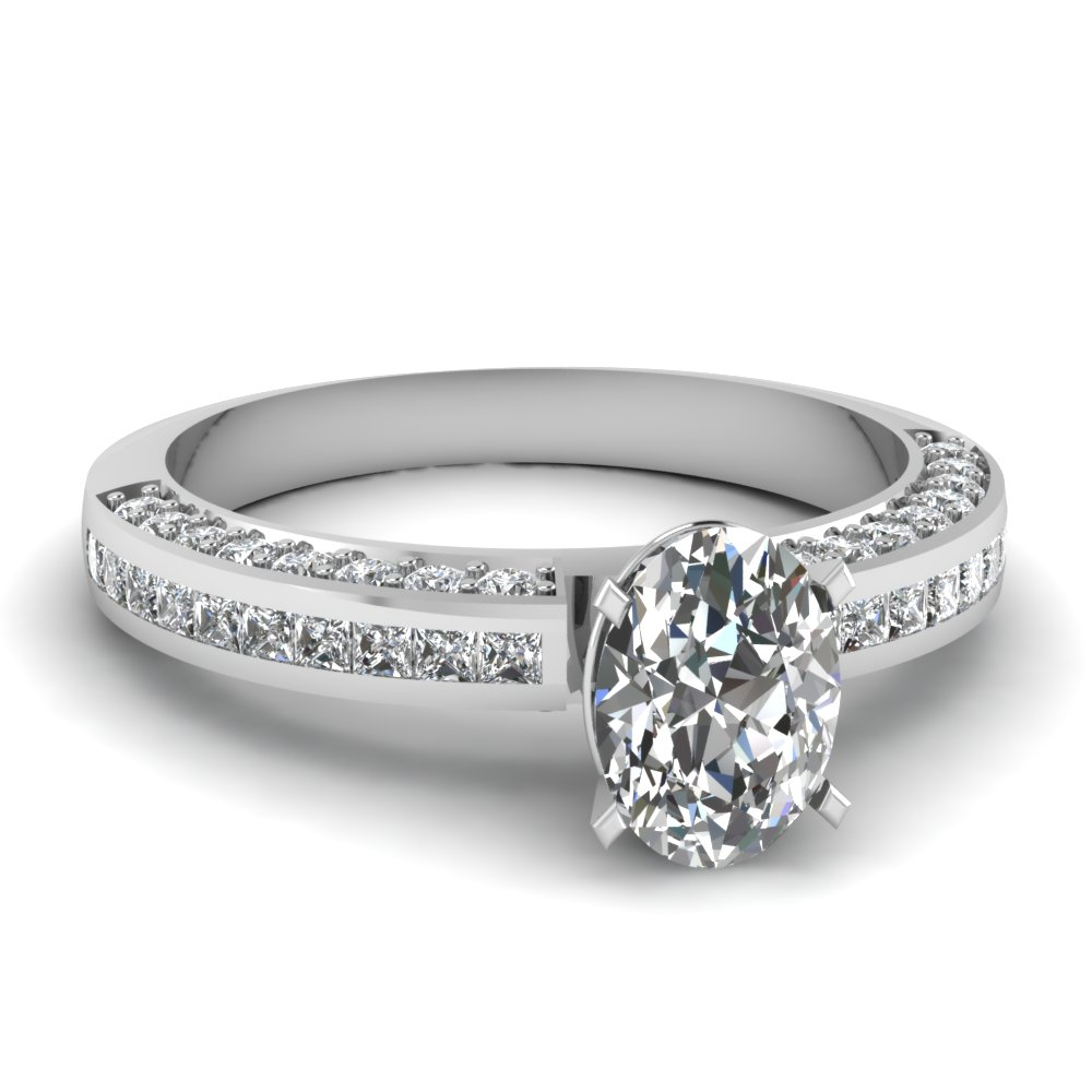 Princess And Round Diamonds Accented Oval Cut Diamond Engagement Ring