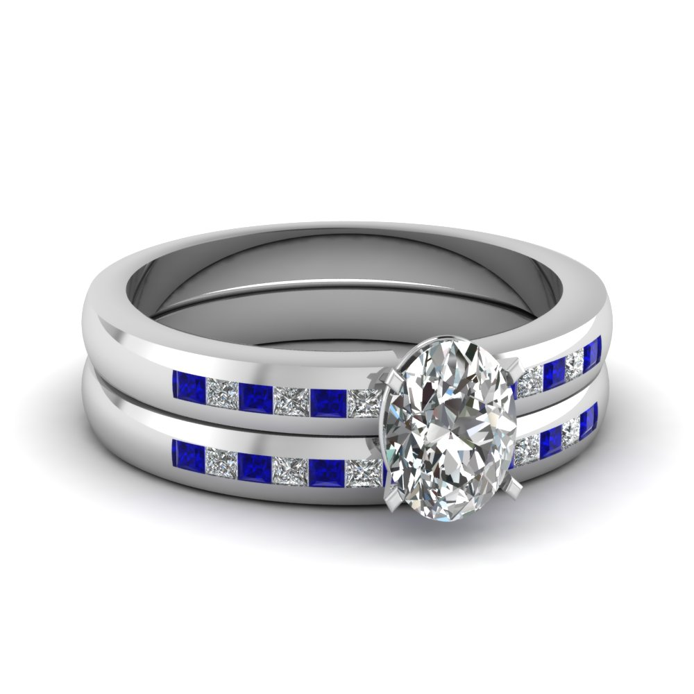 Channel Set Princess Cut Sapphires And Oval Shaped Engagement Ring