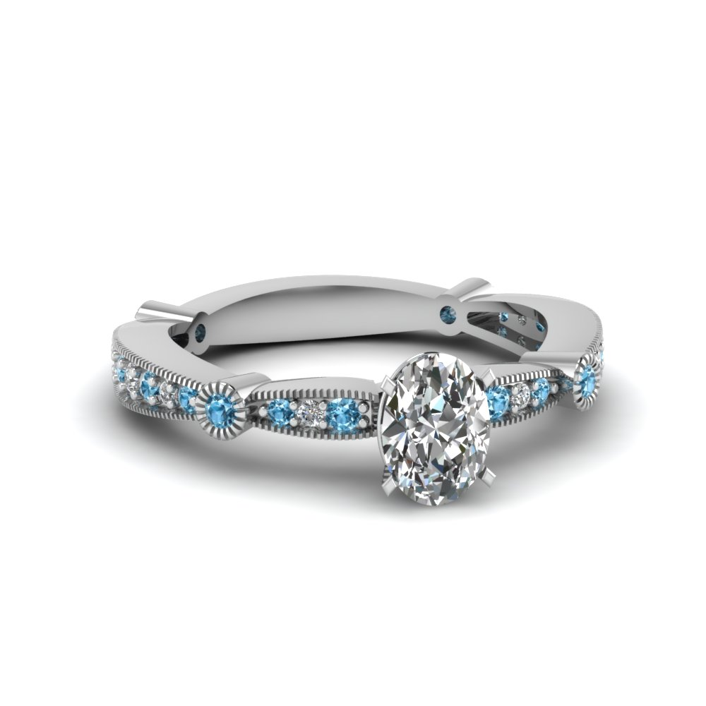 oval diamond vintage tapered engagement ring with blue topaz in FDENS3026OVRGICBLTO NL WG