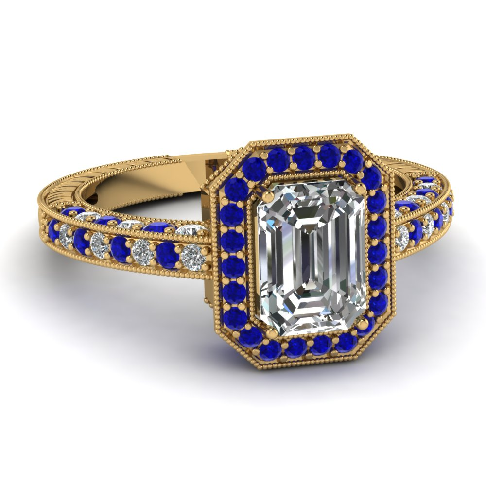 vintage halo emerald cut diamond ring with sapphire in 14k yellow