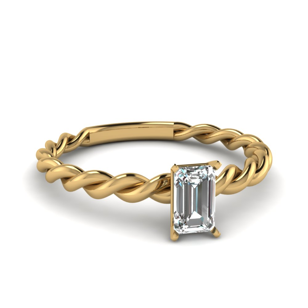 emerald cut solitaire braided ring in 18k yellow gold
