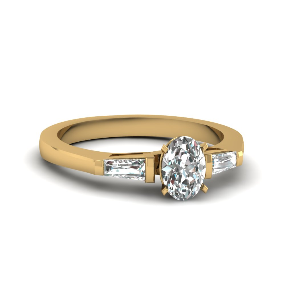 Oval Shaped Three Stone Diamond Ring in 14k Yellow Gold