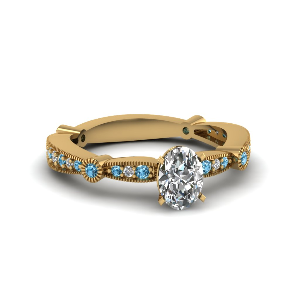 oval diamond vintage tapered engagement ring with blue topaz in FDENS3026OVRGICBLTO NL YG