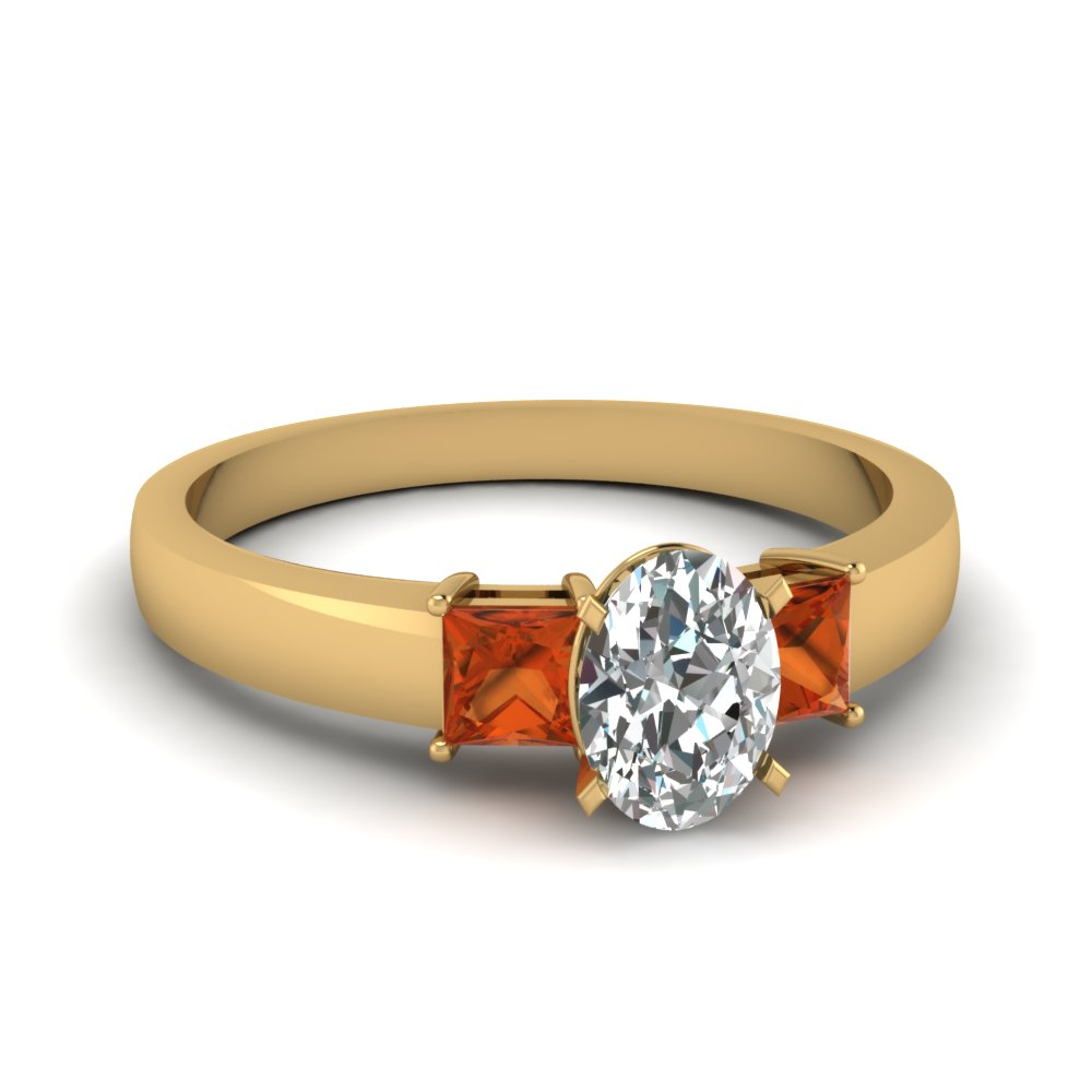 dainty 3 stone oval shaped engagement ring with orange sapphire in FDENS1024OVRGSAOR NL YG