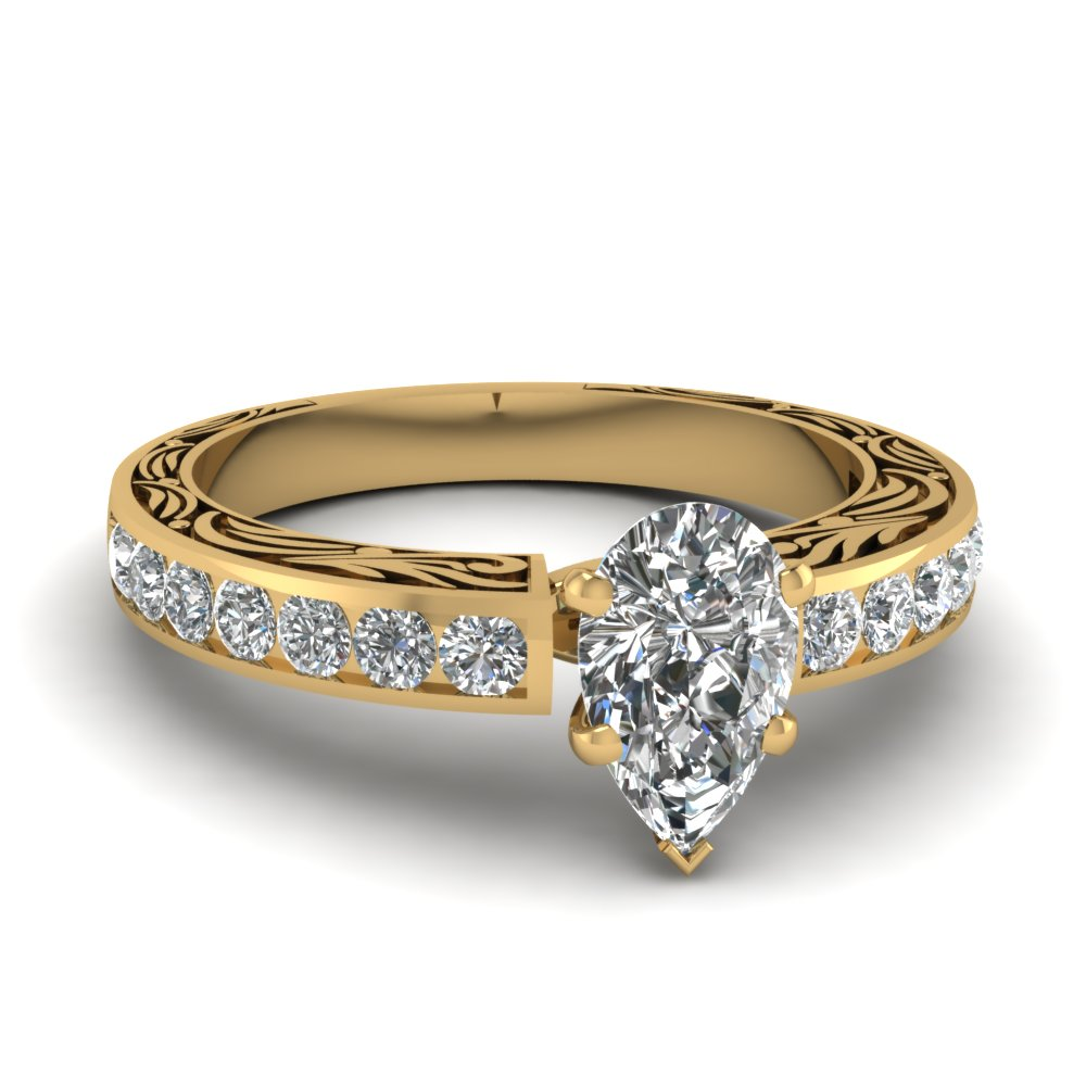Vintage Channel Set Pear Shaped Diamond Engagement Ring In 14K Yellow Gold