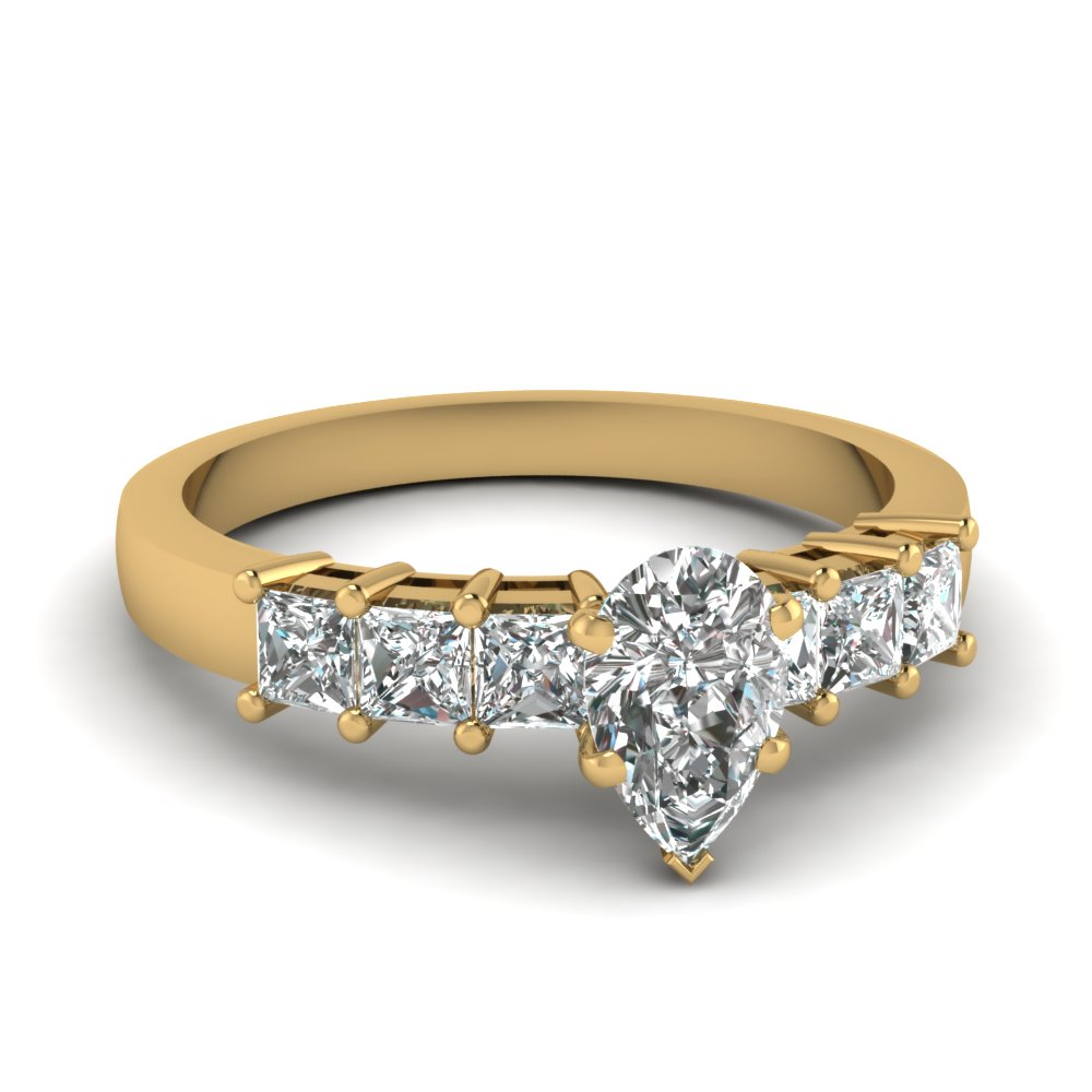 Pear Shaped Diamond With Accents Engagement Ring In Yellow Gold
